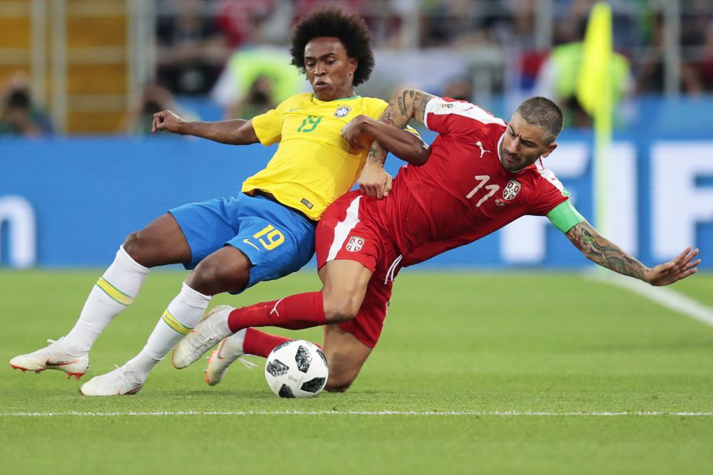 Aleksandar Kolarov gets the tackle in on Willian.