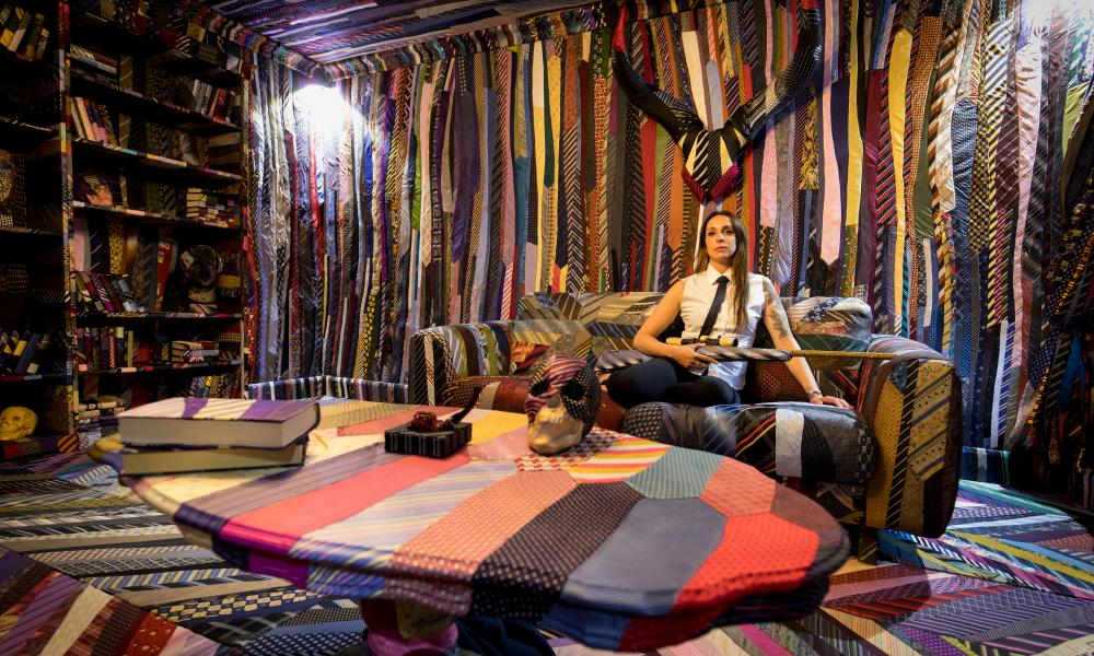 Cole laboriously sewed 27,000 ties ogether to create a traditional gentlemen's living room.