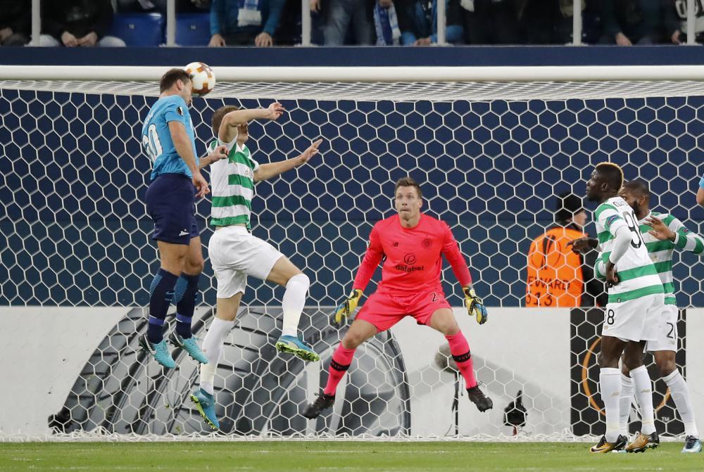 Branislav Ivanovic rises above Simunovic to head home.