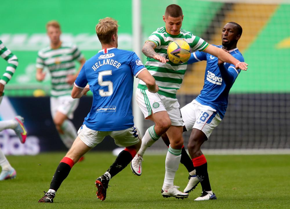 Klimala battles for the ball with Helander and Kamara
