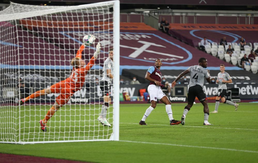 West Ham United's Sebastien Haller heads in his side's second.