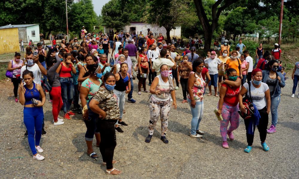 Relatives of inmates protest outside Los Llanos penitentiary after a riot erupted inside the prison leaving dozens of deadin Guanare, Venezuela 2 May 2020.