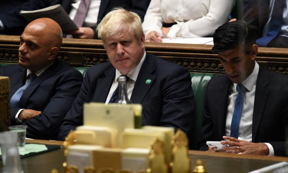 Sajid Javid, Boris Johnson and Rishi Sunak at the unveiling of the new measures in parliament on Tuesday.