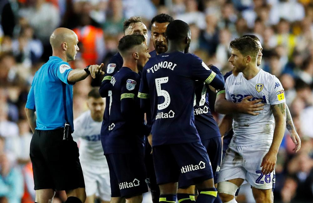 Berardi is sent off by referee Anthony Taylor.