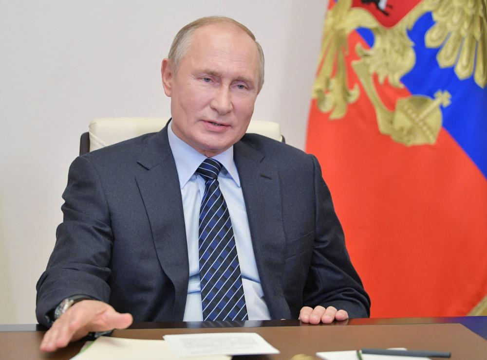 Russia's president Vladimir Putin addresses members of the Russian Union of Industrialists and Entrepreneurs (RSPP) via a video conference call at the Novo-Ogaryovo state residence outside Moscow.