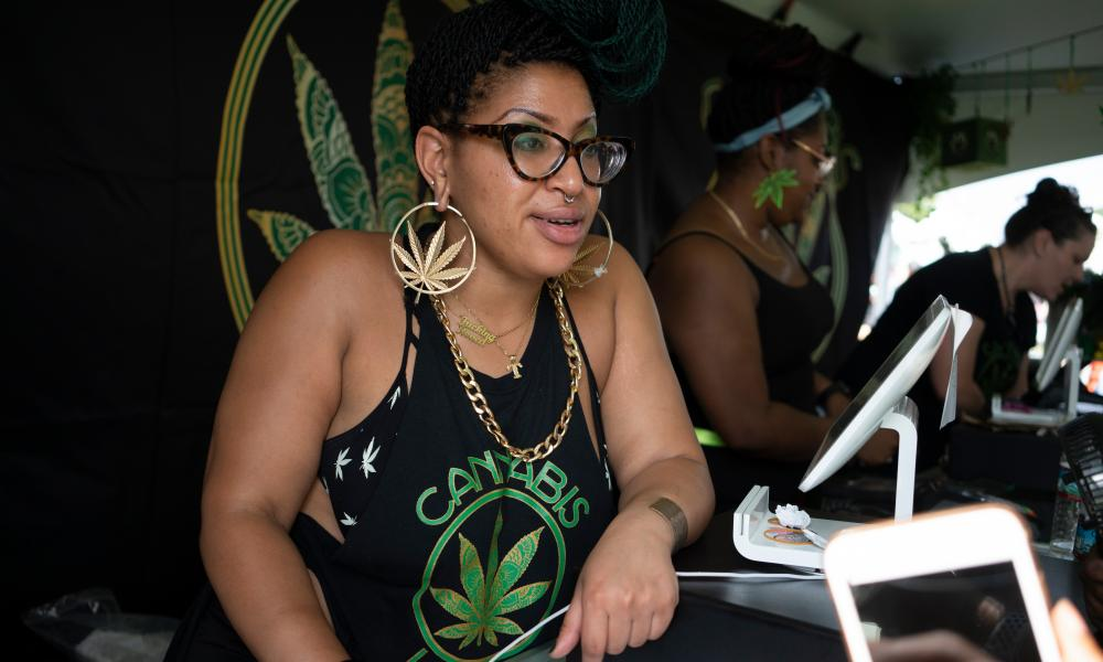 Thandi Dunn sells product at the Cannabis Karma booth during the National Cannabis Festival in Washington DC on 28 August 2021. Cannabis Karma is a black, female-owned and operated business with the mission of normalizing the adult consumption of cannabis.