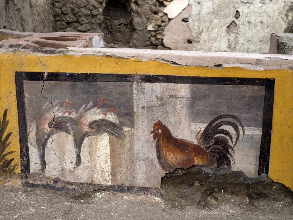 A painting is restored at the thermopolium.