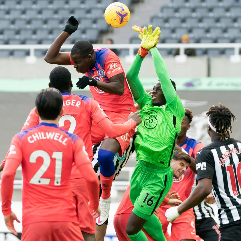 Chelsea's goalkeeper Edouard Mendy deals with a corner.