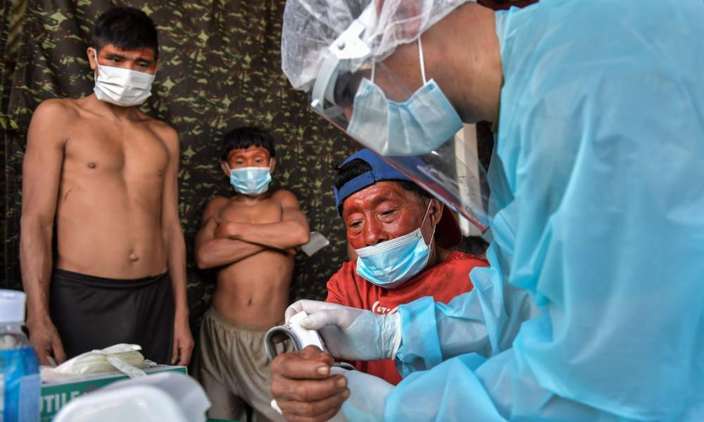 A member of the Brazilian Armed Forces medical team examines a member of the Yanomami ethnic group at a Special Border Platoon, where tests for Covid-19 are being carried out, in the indigenous land of Surucucu, in Alto Alegre, Roraima state, Brazil.