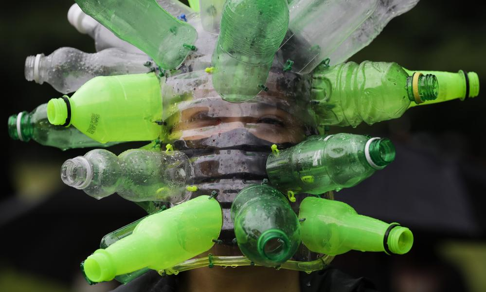 A protester wears a face shield made of recycled plastic bottles by artist Leeroy New during a rally against a counter-terrorism bill on Independence Day in Manila, Philippines.