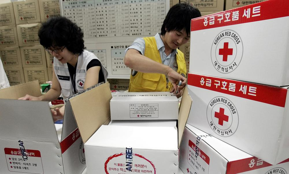 South Korean workers from Korea Red Cross prepare aid supply kits for North Korean flood victims in 2007.