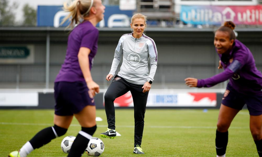 Sarina Wiegman watches a training session ahead of her first game in charge