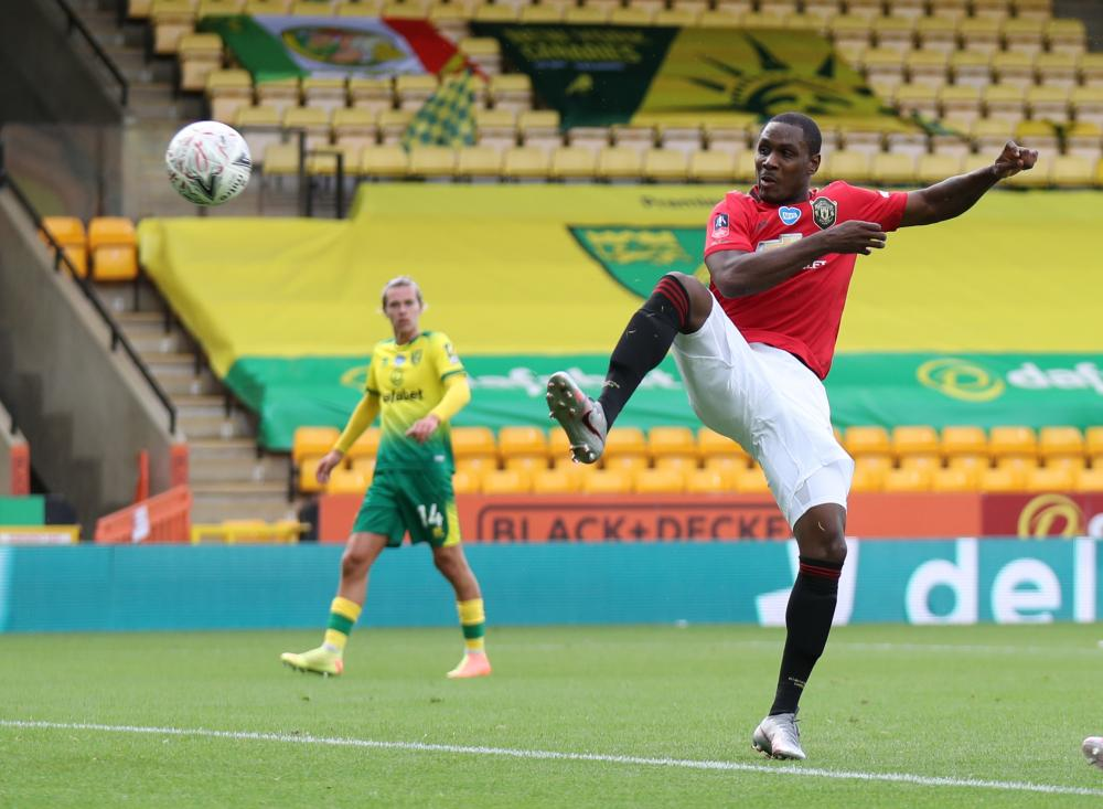 Odion Ighalo poaches to put United ahead.