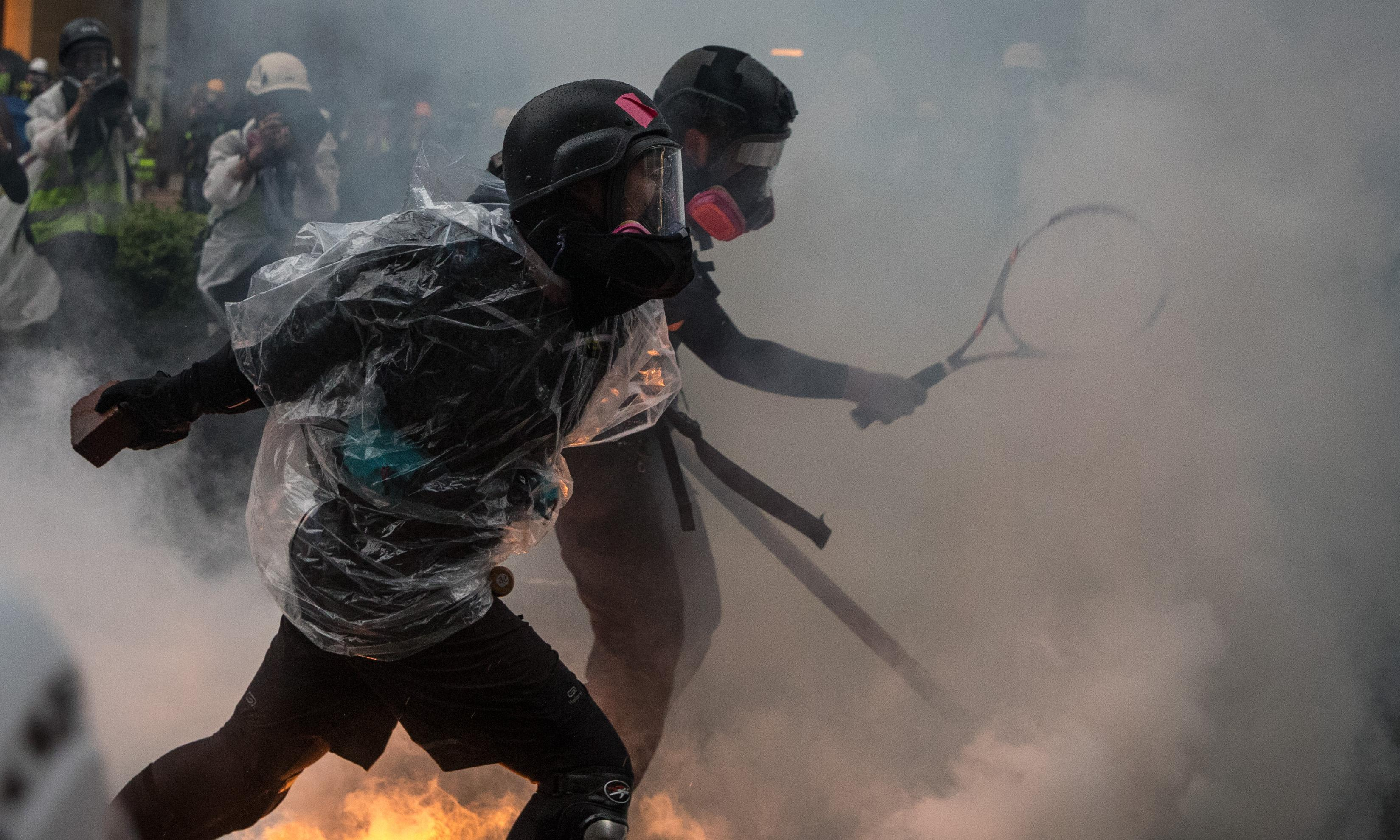 Hong Kong police defend firing live round during latest protests
