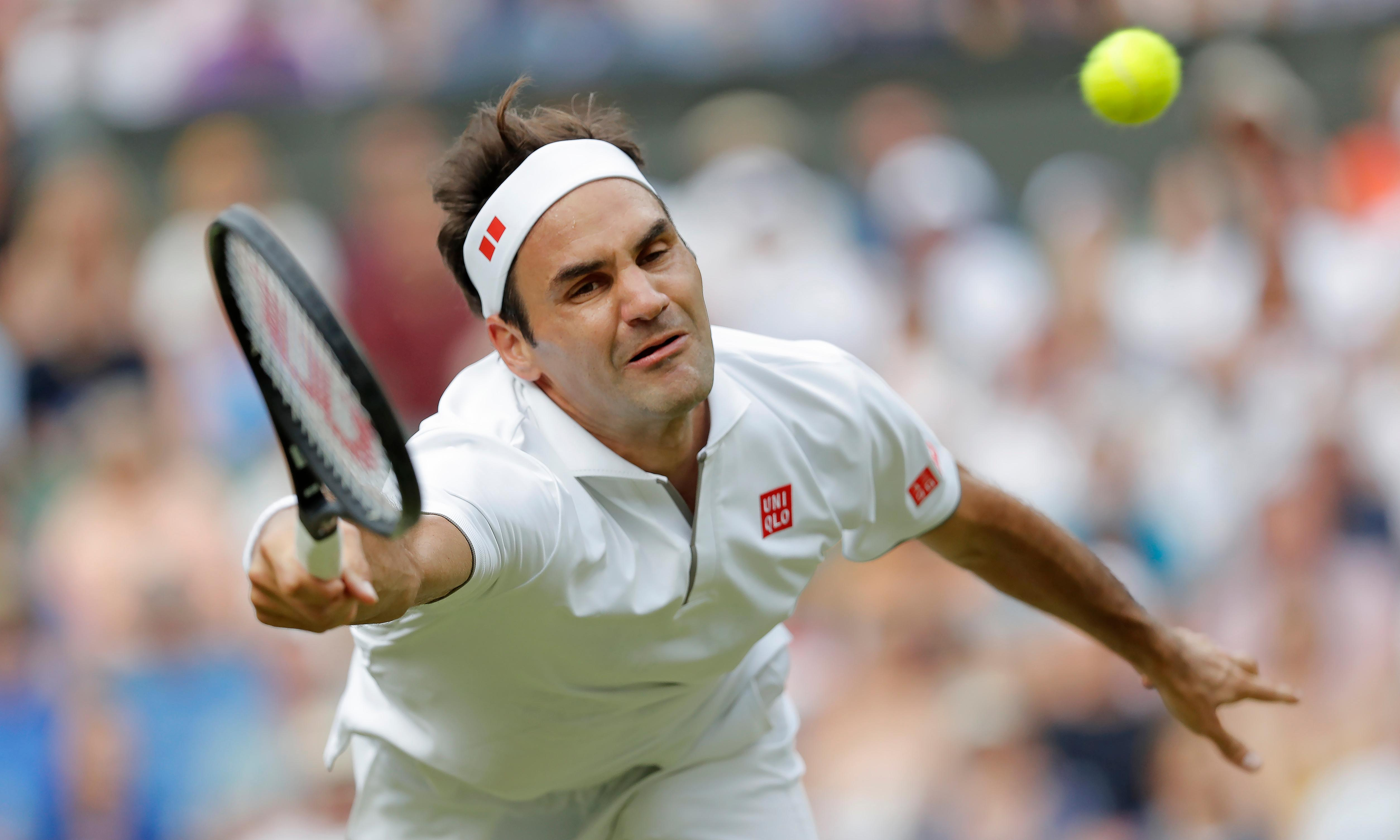 Roger Federer pushed by Kei Nishikori before completing Wimbledon century