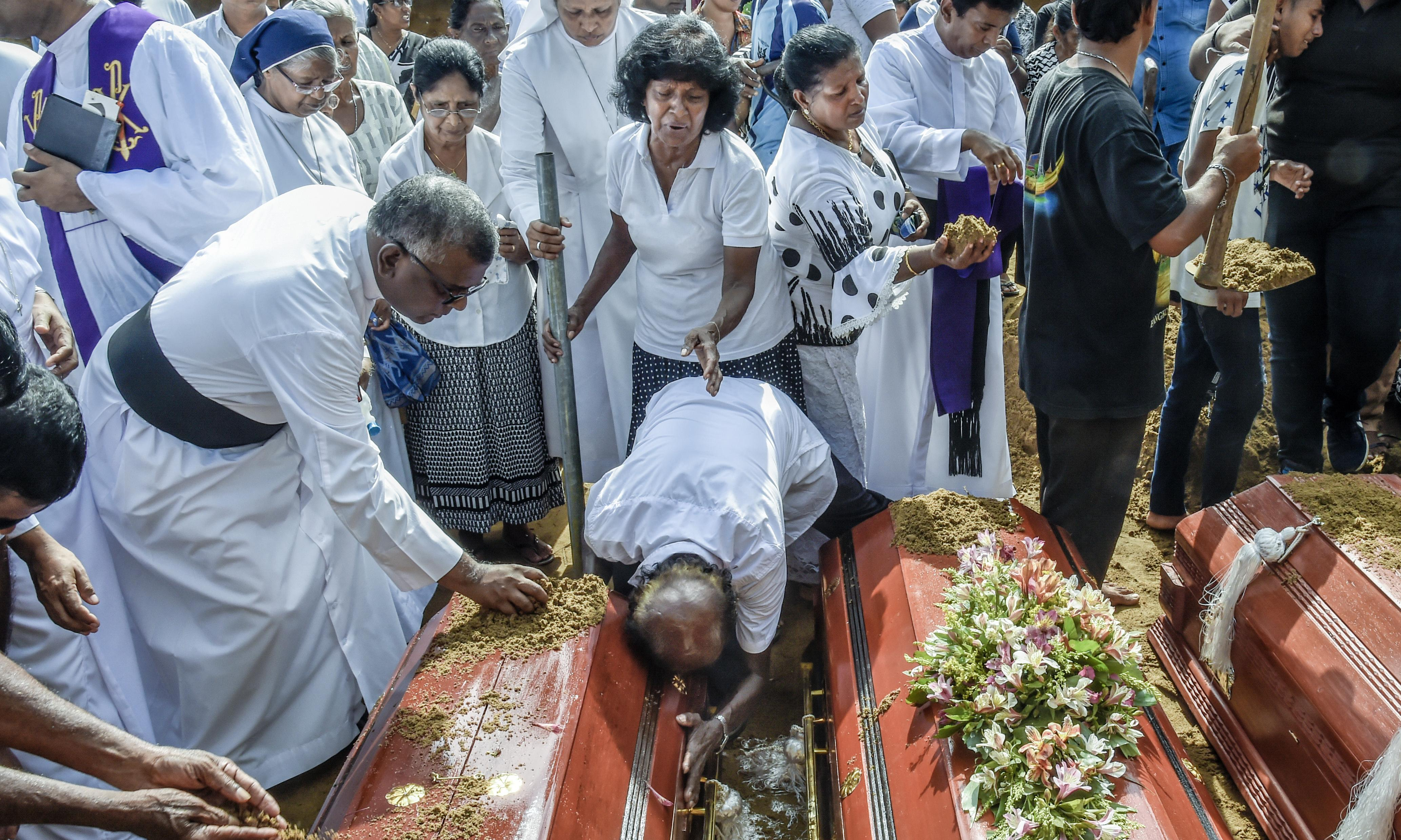 Sri Lanka buries bombing victims as country remains on lockdown