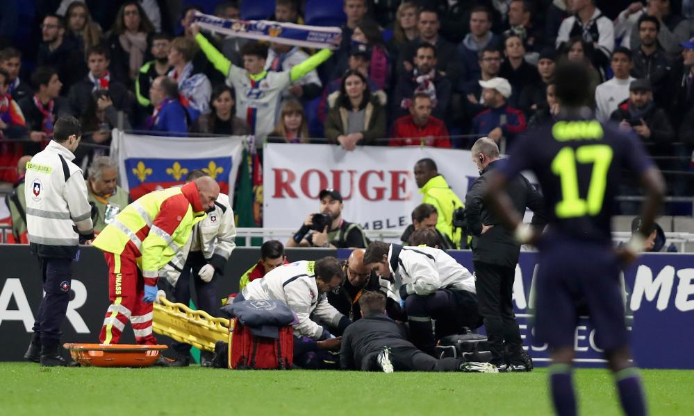 Concerned faces around the ground as Cuco Martina of Everton receives treatment from the medical team.