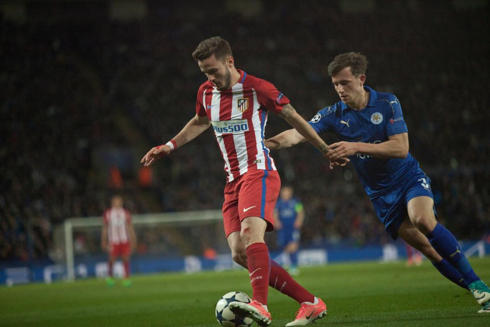 Saul Niguez protects the ball from Ben Chilwell.