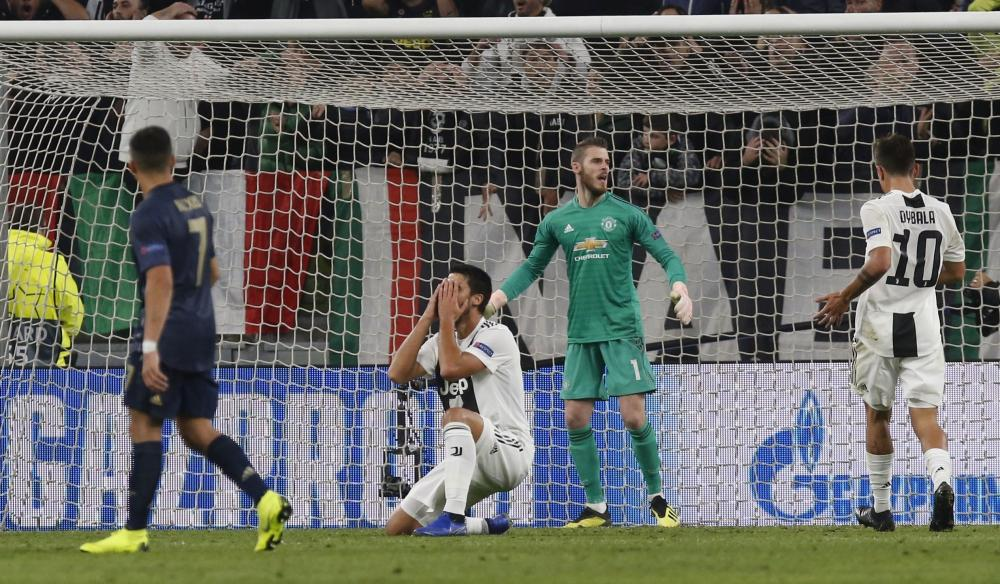 Khedira reacts after hitting the post.