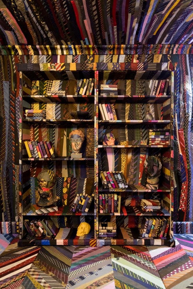 A bookcase of ties.