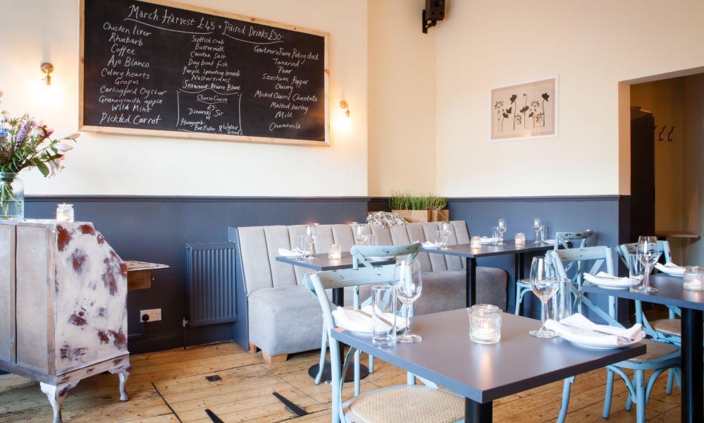 The cream and light blue interior of the Aizle restaurant, Edinburgh, Scotland.