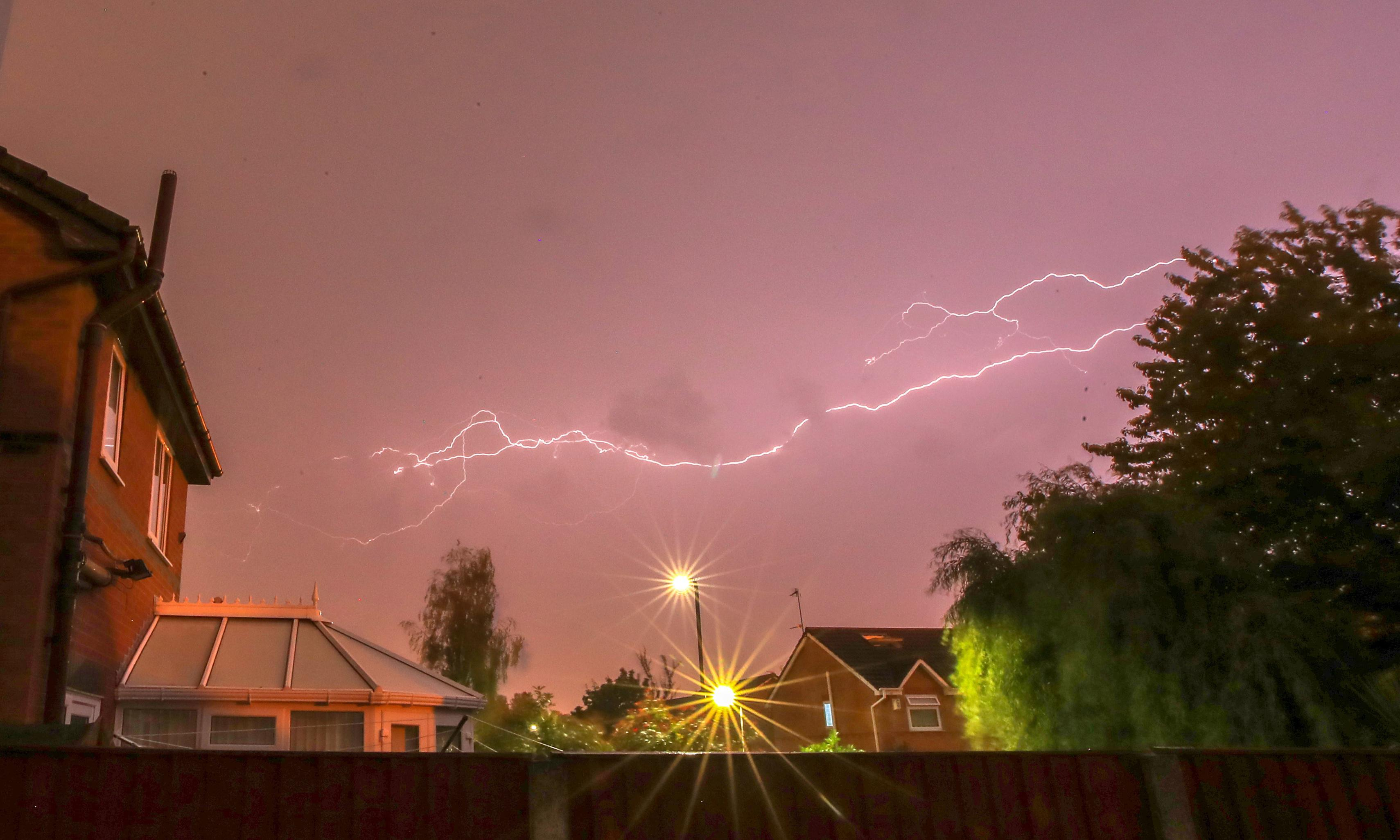 UK weather: lightning strikes as hottest day on record looms