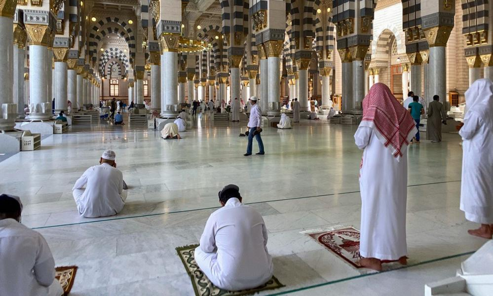 Muslim worshippers perform noon prayer at the Prophet Mohammed's mosque in Saudi Arabia's holy city of Medina.