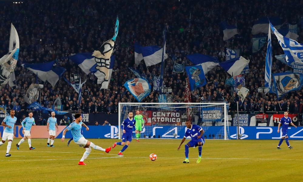 The Schalke fans cheer on their side.