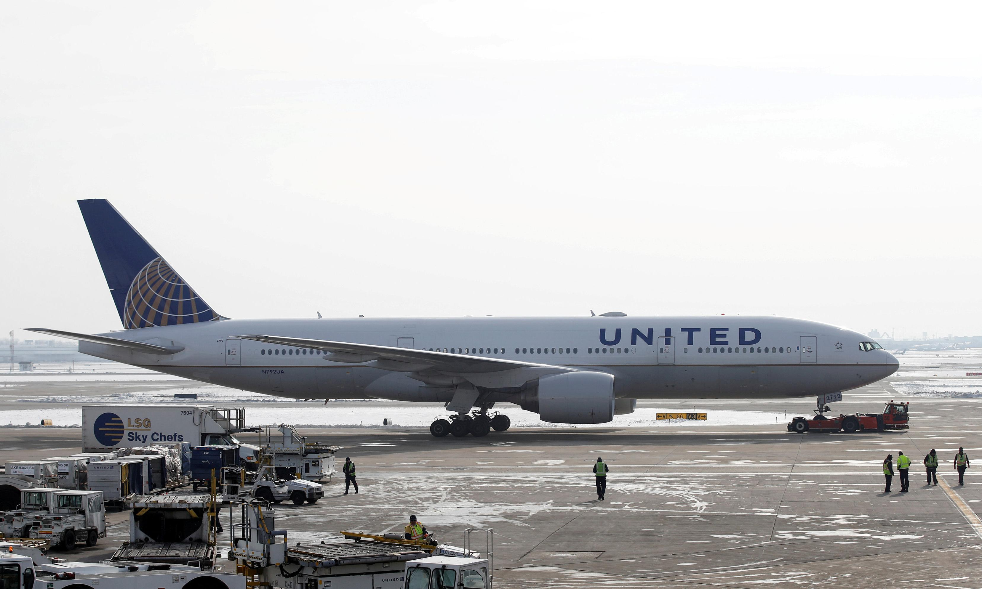 Plane carrying 129 skids off Chicago runway as huge storm hits midwest