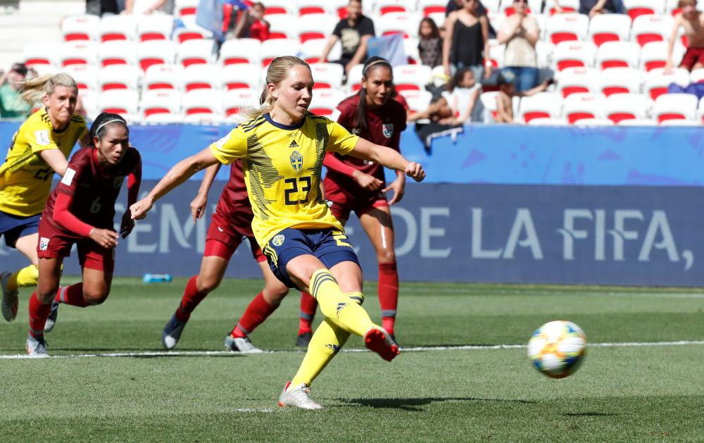 Sweden's Elin Rubensson scores their fifth goal.