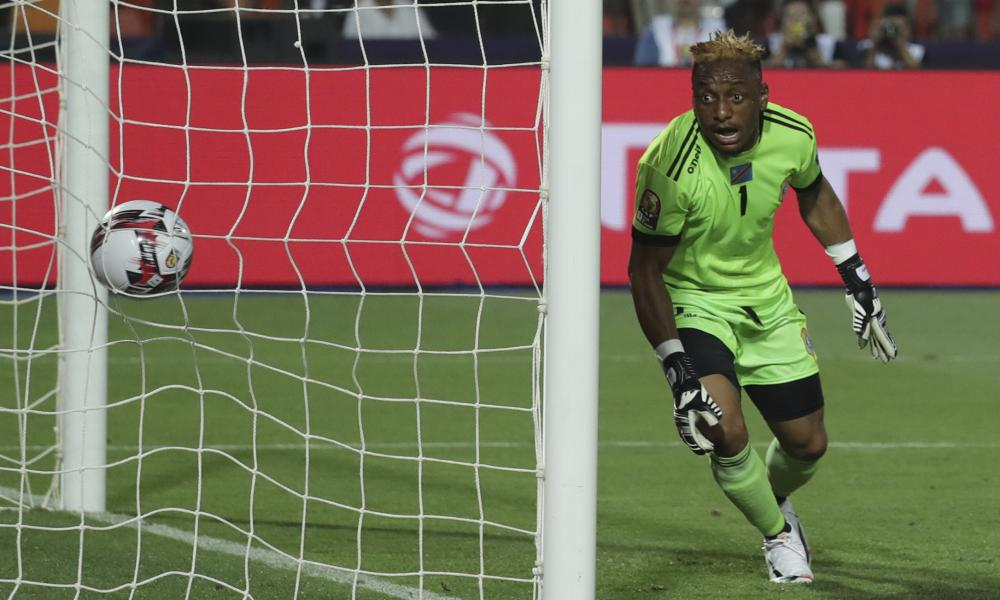Congo's goalkeeper Matampi Ngumbi Ley watches the ball go into the net for Egypt's opening goal.