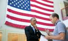 President Barack Obama talks with former Deputy National Security Advisor for Strategic Communications Ben Rhodes.