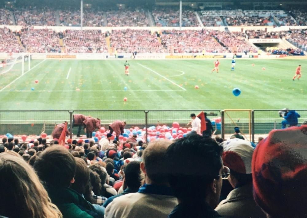 Stewards deal with the many red and blue balloons that the Crystal Palace fans brought to the 1991 Zenith Data Cup final at Wembley Stadium.