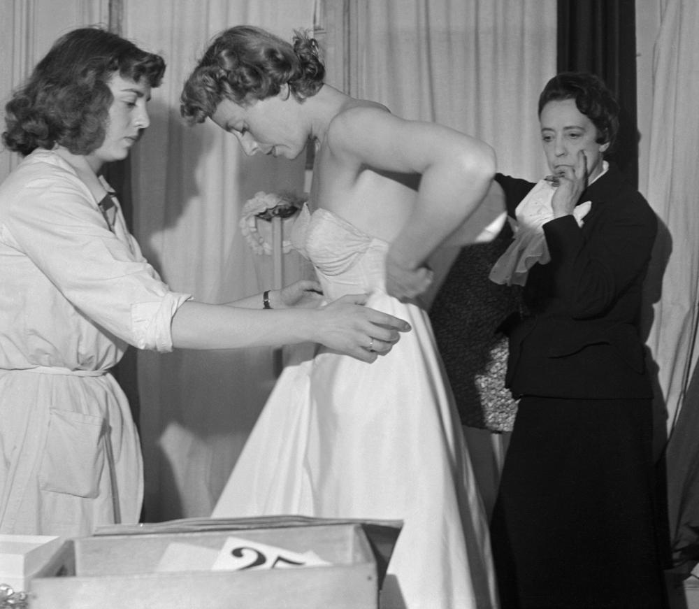 Designer Elsa Schiaparelli fitting a model in Paris.