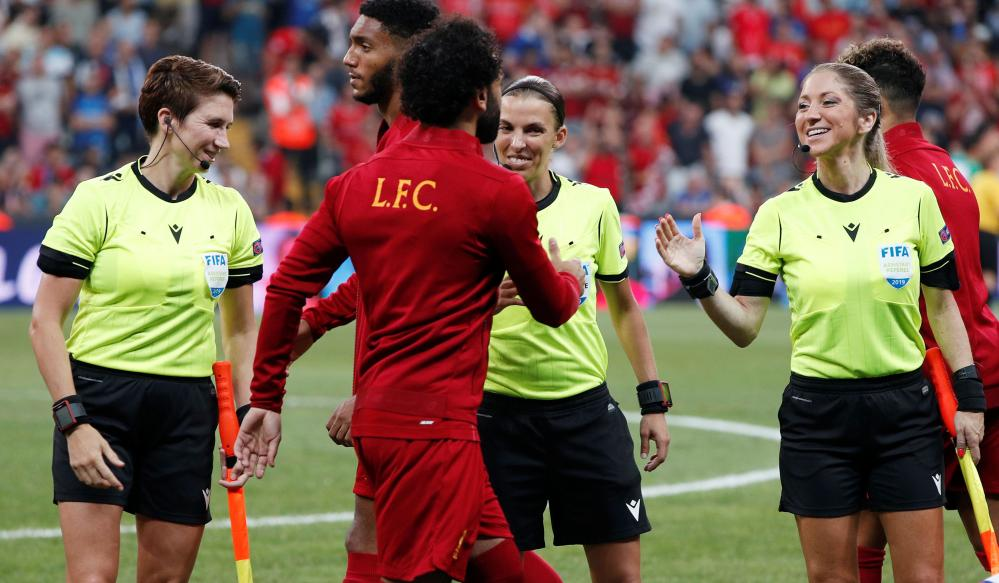 Assistant referee Michelle O'Neill, referee Stephanie Frappart and assistant referee Manuela Nicolosi with Liverpool's Mohamed Salah and Joe Gomez before kick-off.