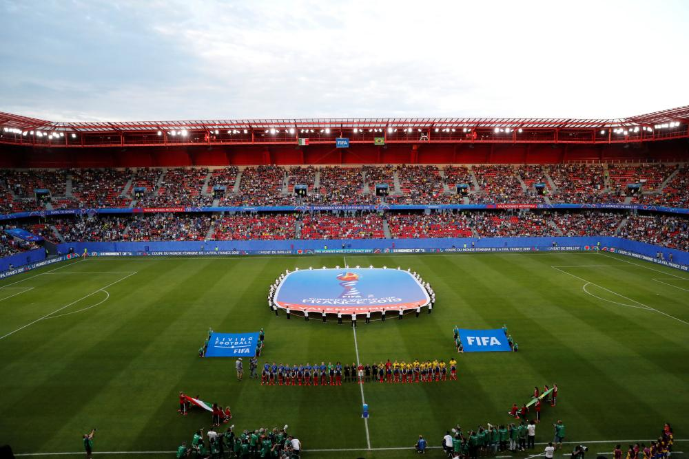 The Brazil and Italy teams line up and the scene is set in Valenciennes.