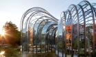 Glasshouses at sunset at the Bombay Sapphire distillery