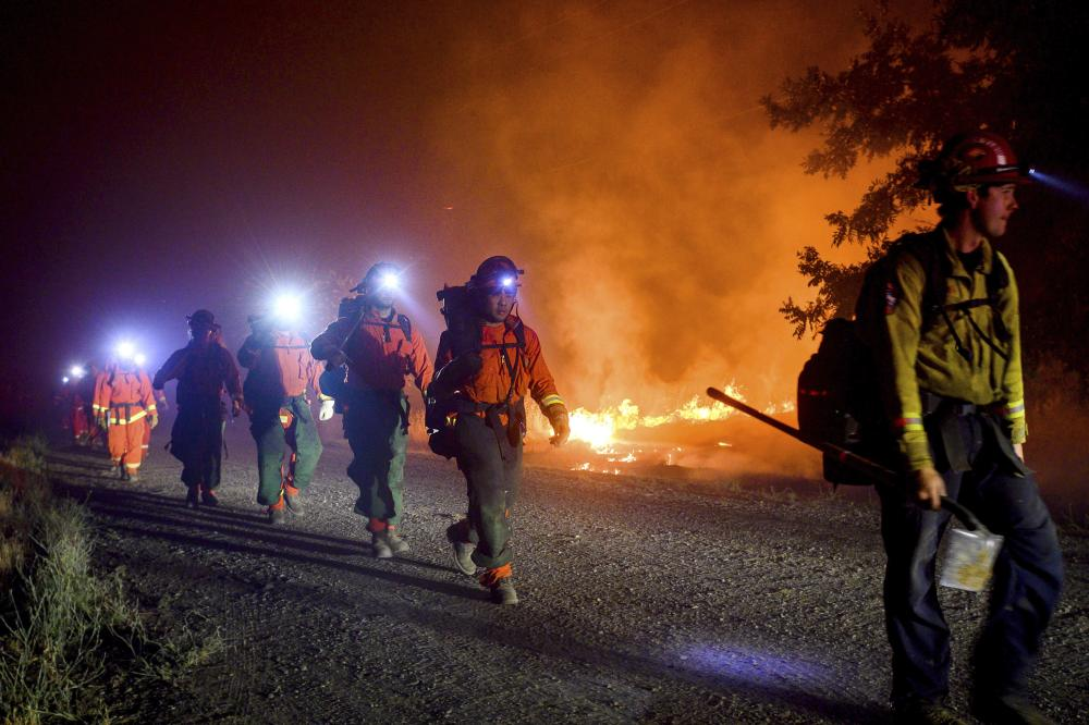 Inmate firefighters battle the Quail fire near Winters, California, on 7 June.