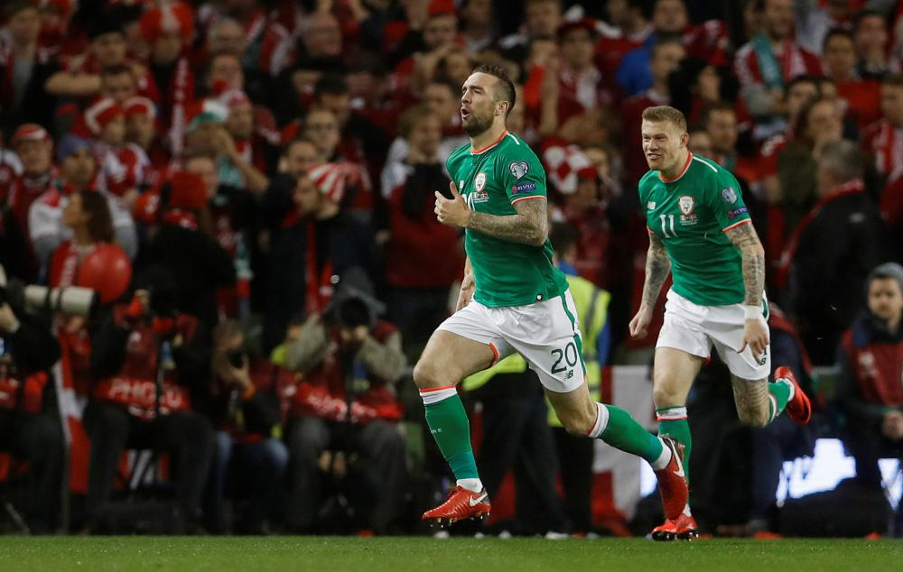 Duffy and James McClean celebrate.
