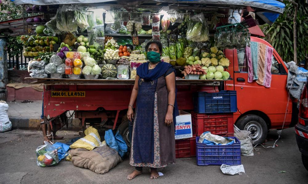 Lalita Kesharwani, 41, vegetable vendor, poses for a picture in front of her stall during a government-imposed nationwide lockdown as a preventive measure against the COVID-19 coronavirus, in Mumbai on April 22, 2020.
