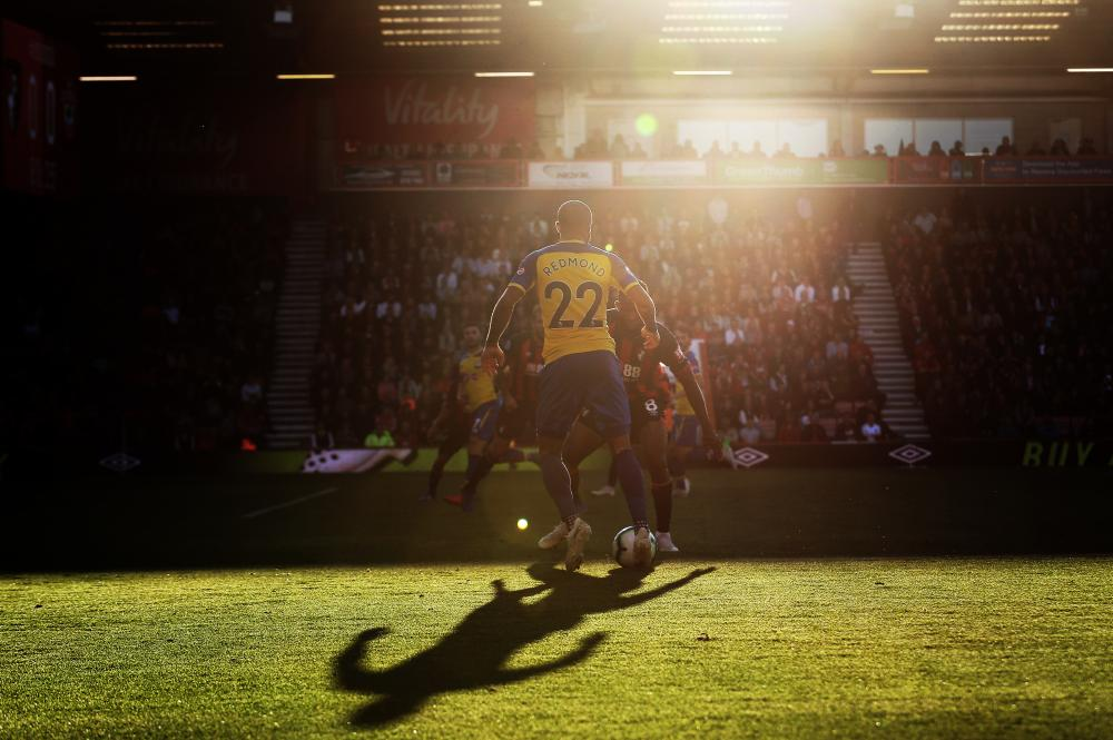 October 20: Nathan Redmond of Southampton on the ball as the sun sets during their match against Bournemouth at the Vitality Stadium.