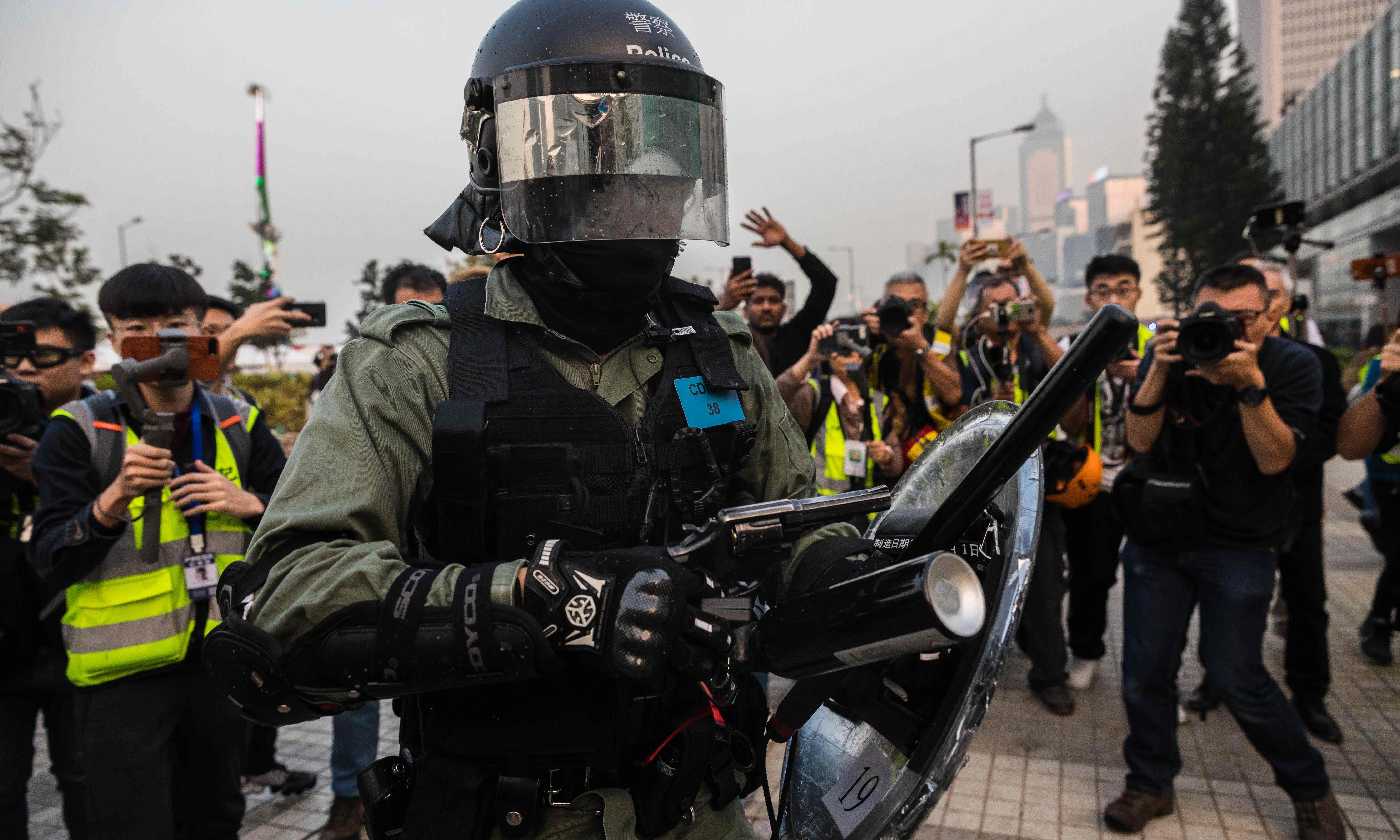 Hong Kong police clash with protesters after Uighur rally