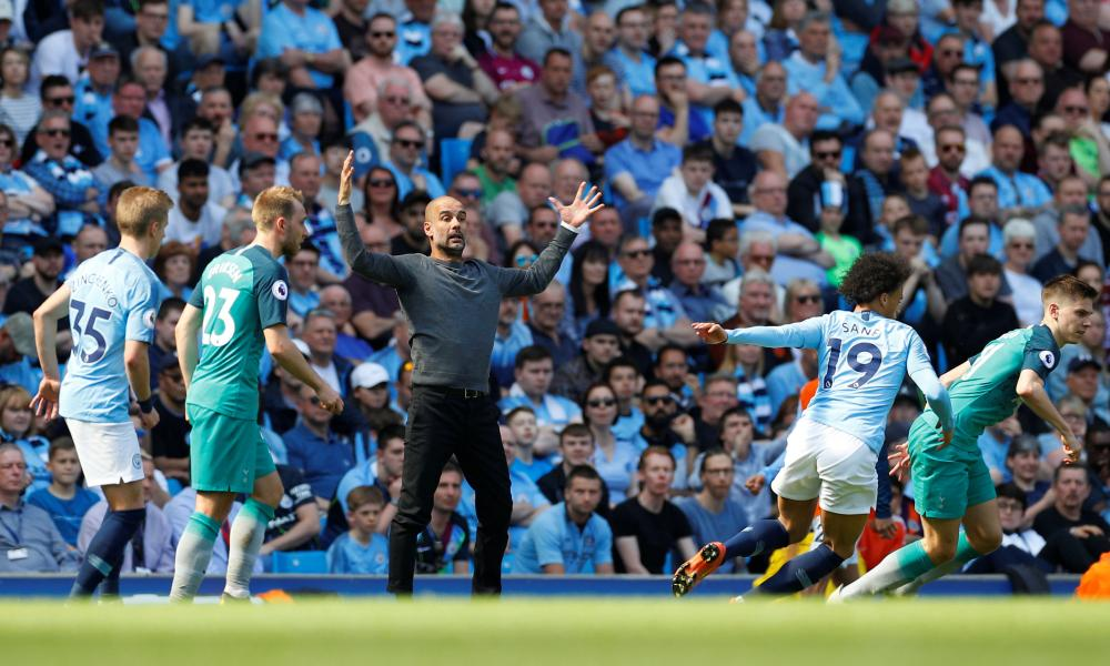 Manchester City manager Pep Guardiola throws some shapes on the touchline.
