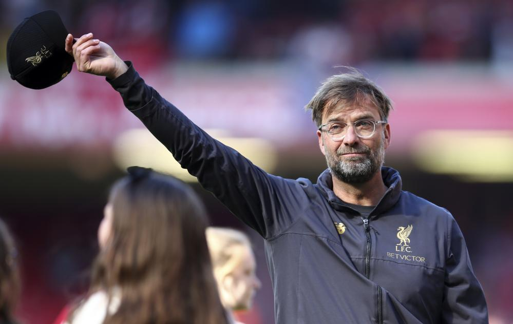 Klopp dons his cap to the fans.
