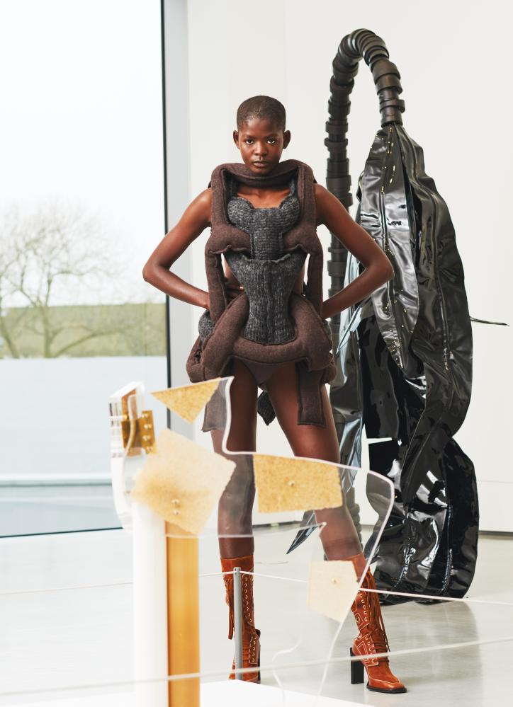 Model in front of Anthea Hamilton and Eva Rothschild artworks at JW Anderson exhibition at Hepworth Wakefield