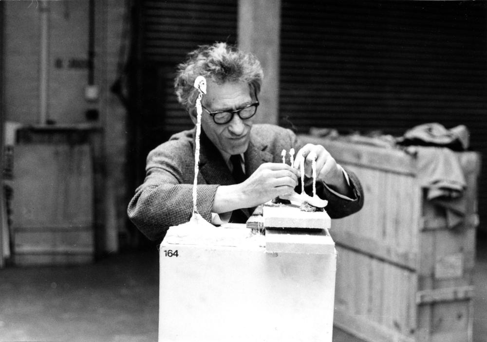 Giacometti working on Four Figurines on a Stand at the Tate Gallery, 1965.