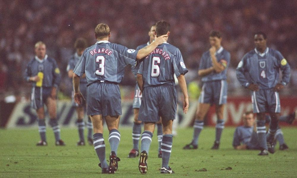 Stuart Pearce consoles Gareth Southgate after his penalty miss in 1996.
