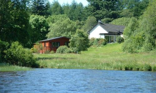 A four-bedroom property near Dalavich, Argyll & Bute, with a stretch of private shore for fishing.