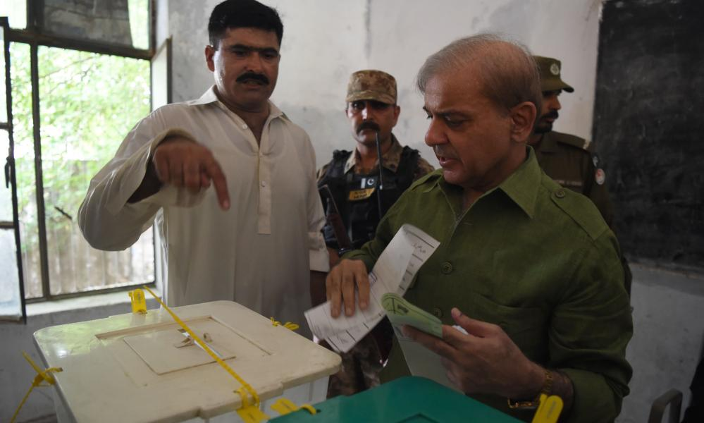 Shehbaz Sharif, the younger brother of ousted prime minister Nawaz Sharif and the head of the PMLN party casts his vote in Lahore.