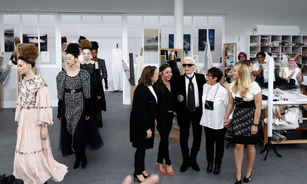 Models file past as Karl Lagerfeld watches from a recreated atelier